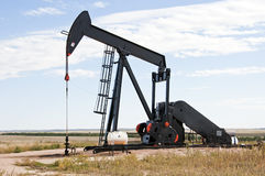 Raised pump jack in Colorado, USA Royalty Free Stock Photos