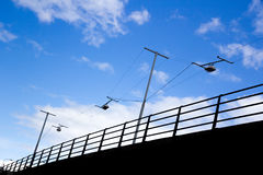 Raised road with railing. And street lights strung across the road Stock Photo