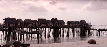Raised shacks by the water Royalty Free Stock Photography