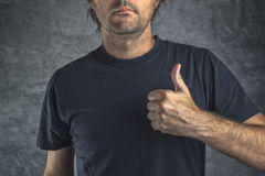 Raised thumb up for approval Royalty Free Stock Image
