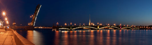 The raised Troitsk bridge in St.-Petersburg. Panorama of the dissolved Troitsk bridge in the city of St.-Petersburg at night stock photos