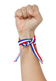 Raised Up Clenched Fist With Tricolor Stripes Wrist Band. Raised Up Clenched Fist With Tricolor Stripes Wrist Band Isolated On White royalty free stock image