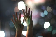 Raised up from the emotions of the hands. At a musical concert Royalty Free Stock Photos