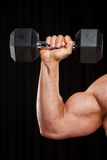 Raised up hand with dumbbell. Stock Photo