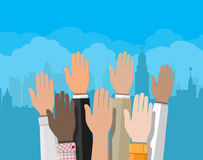 Raised up hands. People vote hands. Stock Photo