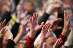 Raised up a human hands at the event. The raised up a human hands at the event Stock Photo