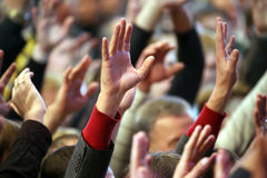 Raised up a human hands at the event Stock Image