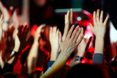 Raised up a human hands at the event Royalty Free Stock Photo