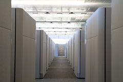 Raised view of cubicle hallway in modern office. Focus end filing cabinet. Shot from the perspective of an employee walking  in a modern clean office Royalty Free Stock Image