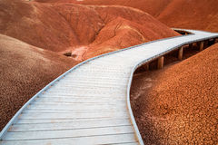 Raised Walkway through the Red Hills of the Painted Hills. Wooden raised walkway through the Red Hills of the Painted Hills Unit of the John Day Fossil Beds Royalty Free Stock Images