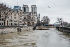Raised water levels of River Seine in Paris, France, Notre-Dame Cathedral on the background royalty free stock image