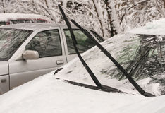 Raised wipers on cars. Windshield glass car mounted in a vertical position Royalty Free Stock Image