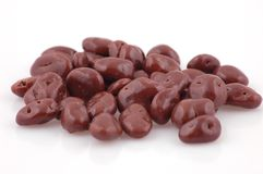 Raisin. In chocolate on the white background Royalty Free Stock Photography
