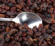Raisin background and teaspoon Royalty Free Stock Photography
