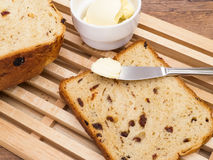 Raisin Bread with Butter. Homemade raisin bread on cutting board with butter Royalty Free Stock Photos