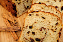 Raisin Bread Closeup. Slices of raisin cinnamon bread with slices laid out showing the detail in the slice including the raisins Royalty Free Stock Image