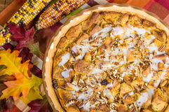 Raisin bread pudding desert with fall decorations Stock Photography