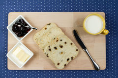 Raisin Bread Slices. Fresh raisin bread with a cup of milk Stock Photo