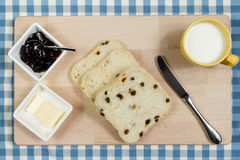 Raisin Bread Slices. Fresh raisin bread with a cup of milk Stock Image