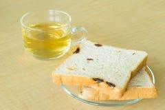 Raisin bread with tea on desk. Fresh raisin bread with tea on desk Royalty Free Stock Image