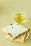 Raisin bread with tea on desk. Fresh raisin bread with tea on desk Royalty Free Stock Photo