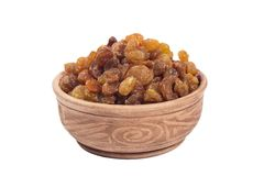 Raisin in brown cup. Isolated on the white background Royalty Free Stock Images