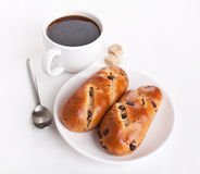 Raisin Buns and Coffee. Two Buns with Raisins and a Cup of Coffee Royalty Free Stock Photography