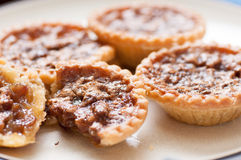 Raisin butter tarts. Delicious butter tarts with raisins and a flaky crust Royalty Free Stock Photography