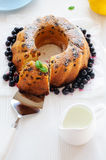 Raisin cake with one piece cut off Royalty Free Stock Photo