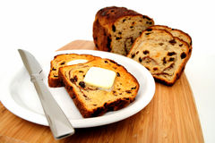 Raisin Cinnamon Toast. Raisin bread toast with melting butter on top ready to be spread Royalty Free Stock Images