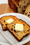 Raisin Cinnamon Toast. Raisin bread toast with melting butter on top ready to be spread Stock Images