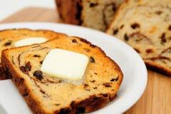 Raisin Cinnamon Toast. Raisin bread toast with melting butter on top ready to be spread Stock Photography