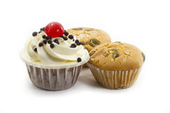 Raisin cup cake and black forest cup cake. On white background Royalty Free Stock Photos