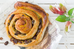 Raisin Danish pastry swirl, brioche. On white wooden tray Royalty Free Stock Photo
