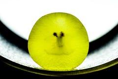 Raisin de Jucy sur le fond noir et blanc Photo stock