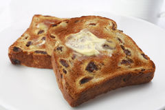 Raisin Fruit Toast with Polyunsaturated Margarine. Heart healthy, polyunsaturated sunflower oil margarine, melting into raisin toast Stock Photography