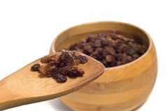 Raisin Ingredient. A wooden spoon full of raisins show of an ingredient for cookies or something, shot on white Stock Image