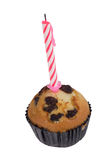 Raisin muffin with candle Stock Images