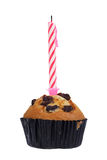 Raisin muffin with candle. Isolated on white background Stock Photography