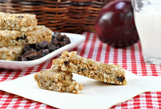 Raisin, oat and nut granola bar on a napkin. Stock Photo