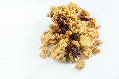 Raisin sec et amande de granola d'isolement photographie stock libre de droits