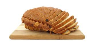 Raisin Sweet Bread. Fresh loaf of sliced raisin sweet bread on a wood cutting board Stock Photos