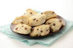 Raisin tea biscuits. Fresh baked raisin tea biscuits on white background Royalty Free Stock Photo