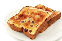 Raisin  Toast. Thick-cut raisin bread, with melting butter Royalty Free Stock Photo