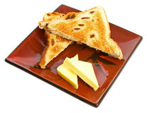 Raisin Toast. Freshly raisin toast with butter on a square serving plate over white background Royalty Free Stock Photography