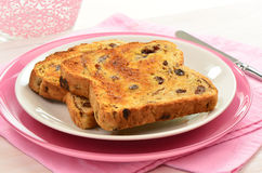 Raisin toast. On pink china Stock Images