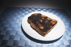 Raisin Toast on Plate. On Blue Placemat Royalty Free Stock Photography