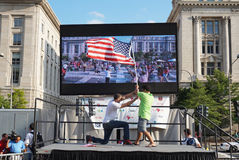 Raising the Americn Flag. Photo of fans raising the american flag at  freedom plaza in washington dc after the world cup soccer game pitting belgium against the Stock Photography