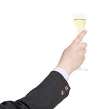 Raising of champagne glass in businessman hand Stock Photos
