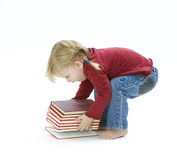 Raising from floor of book small young girl Stock Photography